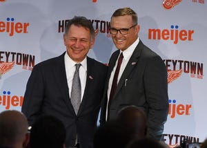 Ken Holland, left, and Steve Yzerman pose for photos on Friday.