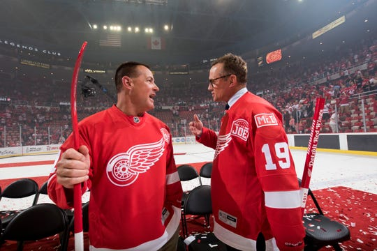 Mike Sawchuk, son of Red Wings great Terry Sawchuk, chats with former Red Wings captain Steve Yzerman after the ceremony for the final game at Joe Louis Arena in 2017.