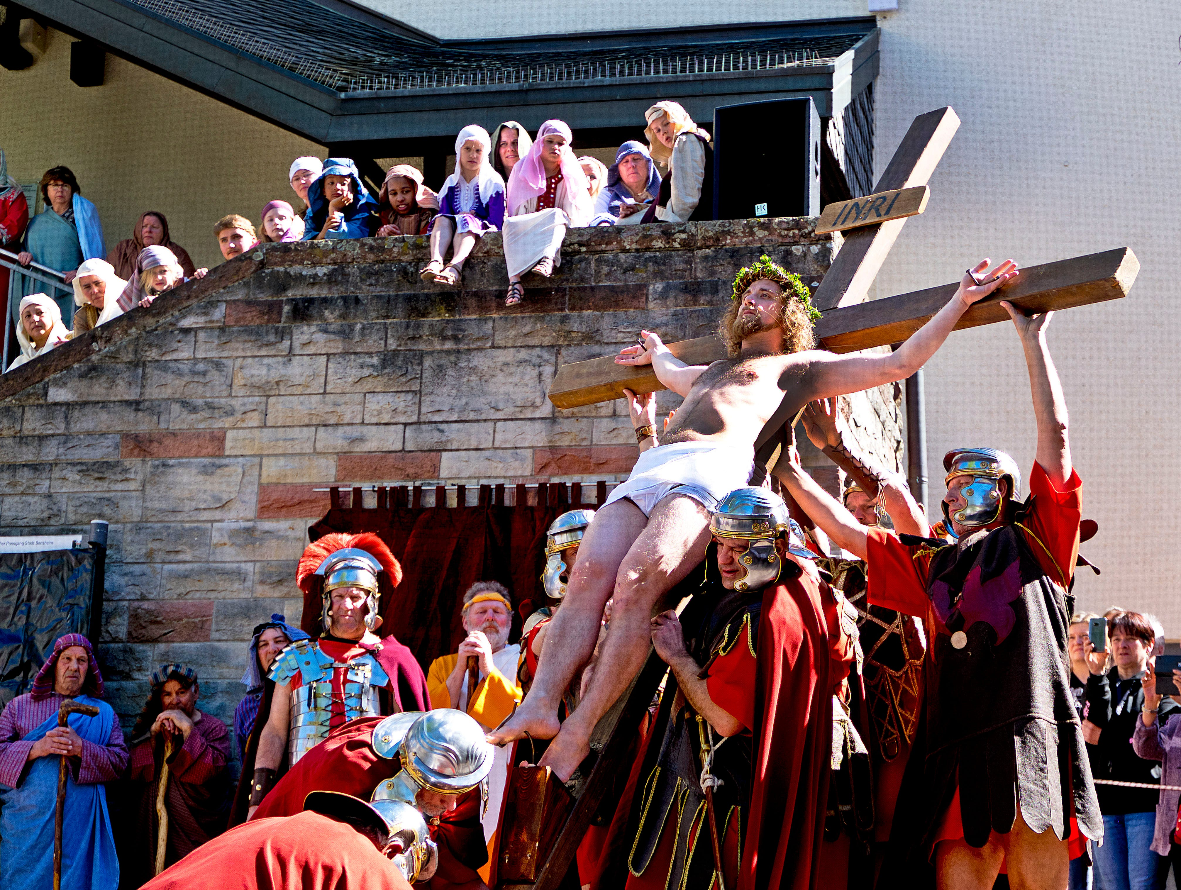 An actor playing Jesus is fixed on a cross in the city of Bensheim near Frankfurt, Germany, on Good Friday, April 19, 2019. Hundreds of spectators watched the annual Passion re-enacting the crucifixion of Jesus Christ organized by the Italian catholic community.