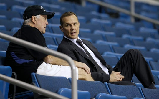 Steve Yzerman, here talking with Lightning assistant coach Wayne Fleming in 2011, led the Lightning to the playoffs six times in nine seasons.