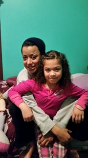 Two of Ira Heyward Sr.'s grandchildren, Nakyiah Martin, front, and Brittany Mucci.