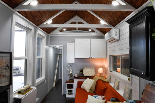 Interior living area in the 8.6 x 28 ft. tiny-home ready for delivery at Jan Tomasik's Blue Sky Tiny Homes Wednesday, April 17, 2019.
