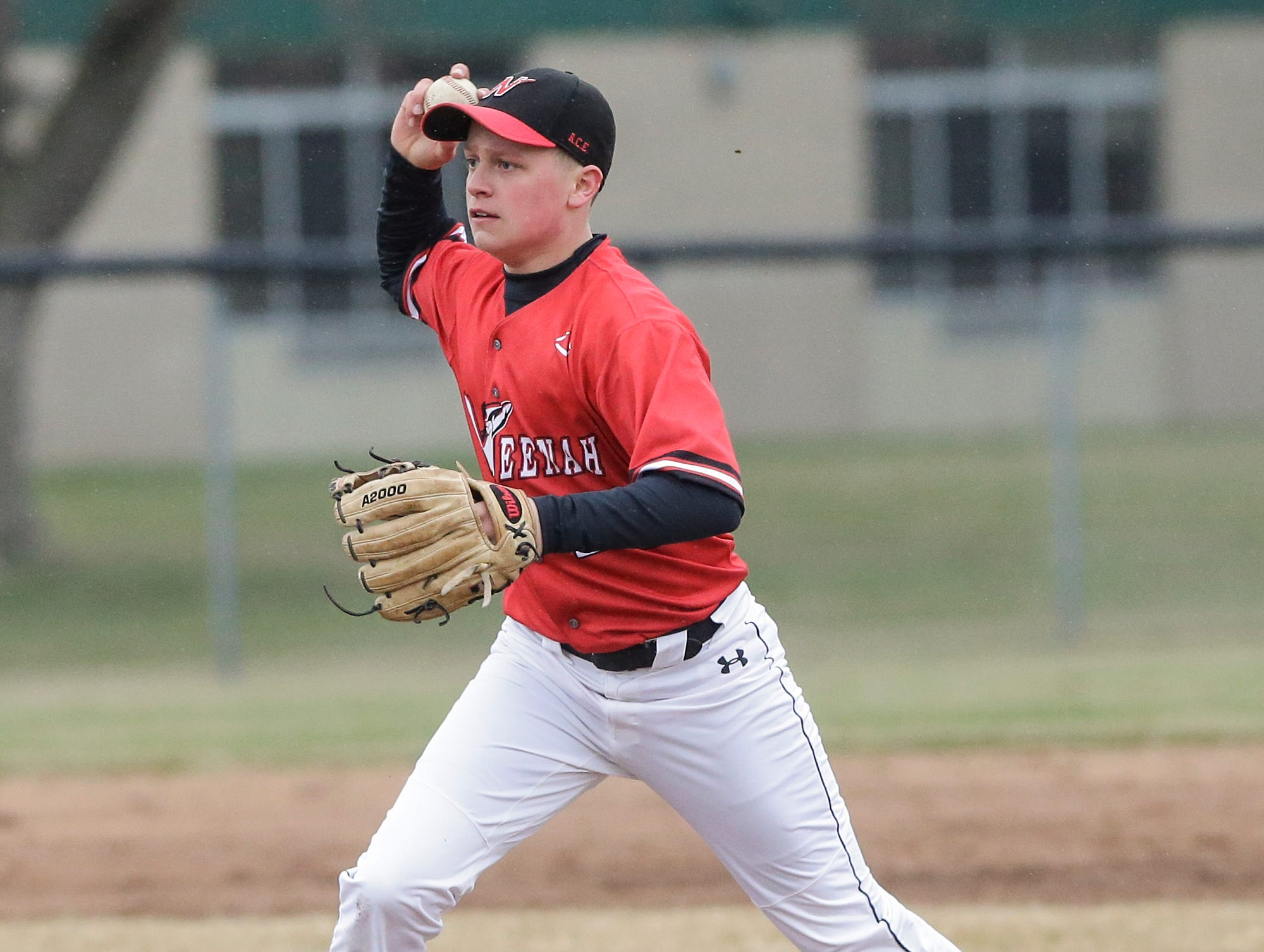 Neenah High School baseball's Chase Hanselman fields a ground ball against Fond du Lac High School during their game Thursday, April 18, 2019 in Fond du Lac, Wis. Doug Raflik/USA TODAY NETWORK-Wisconsin