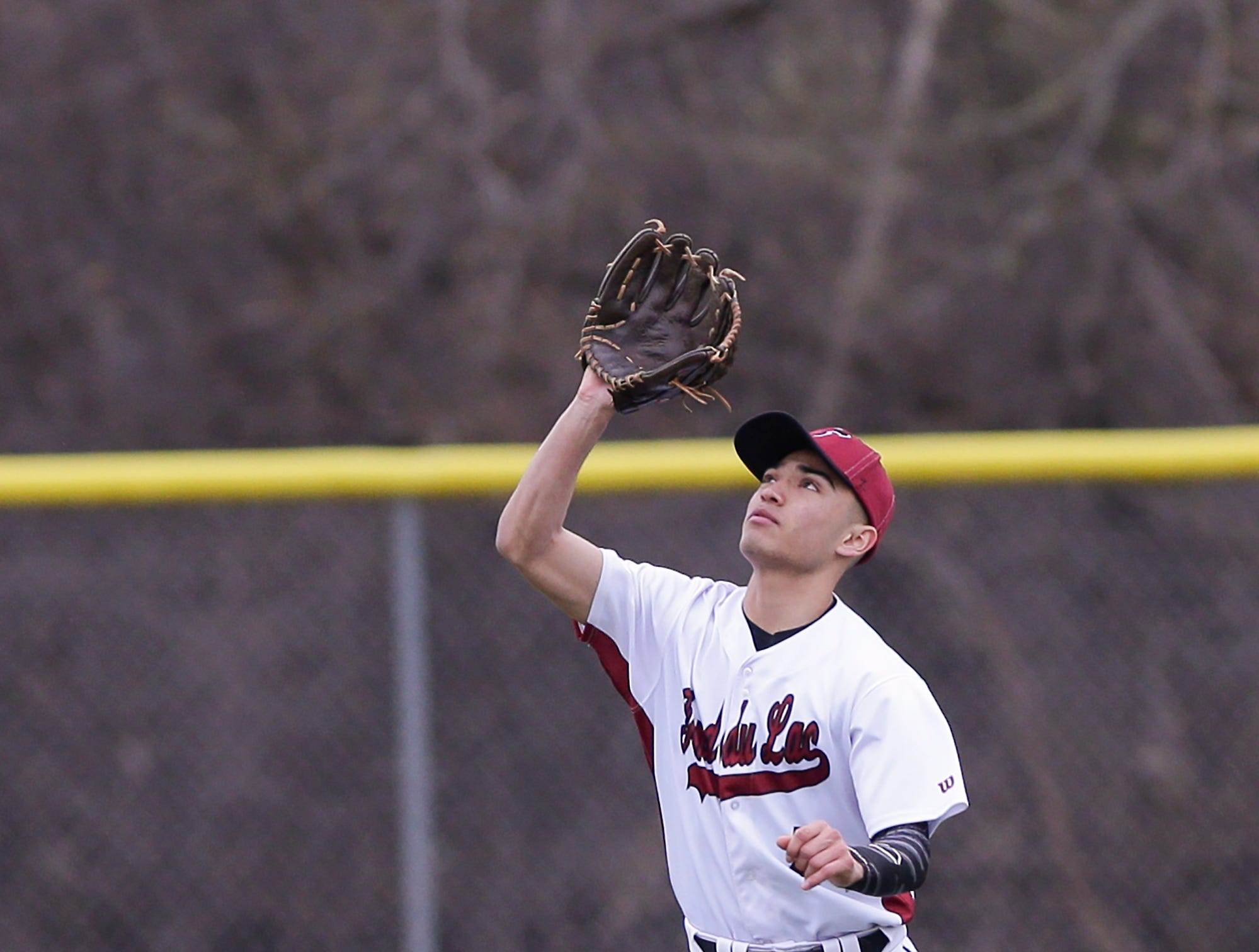 Fond du Lac High School baseball's Julian Murillo catches a fly ball against Neenah High School during their game Thursday, April 18, 2019 in Fond du Lac, Wis. Doug Raflik/USA TODAY NETWORK-Wisconsin