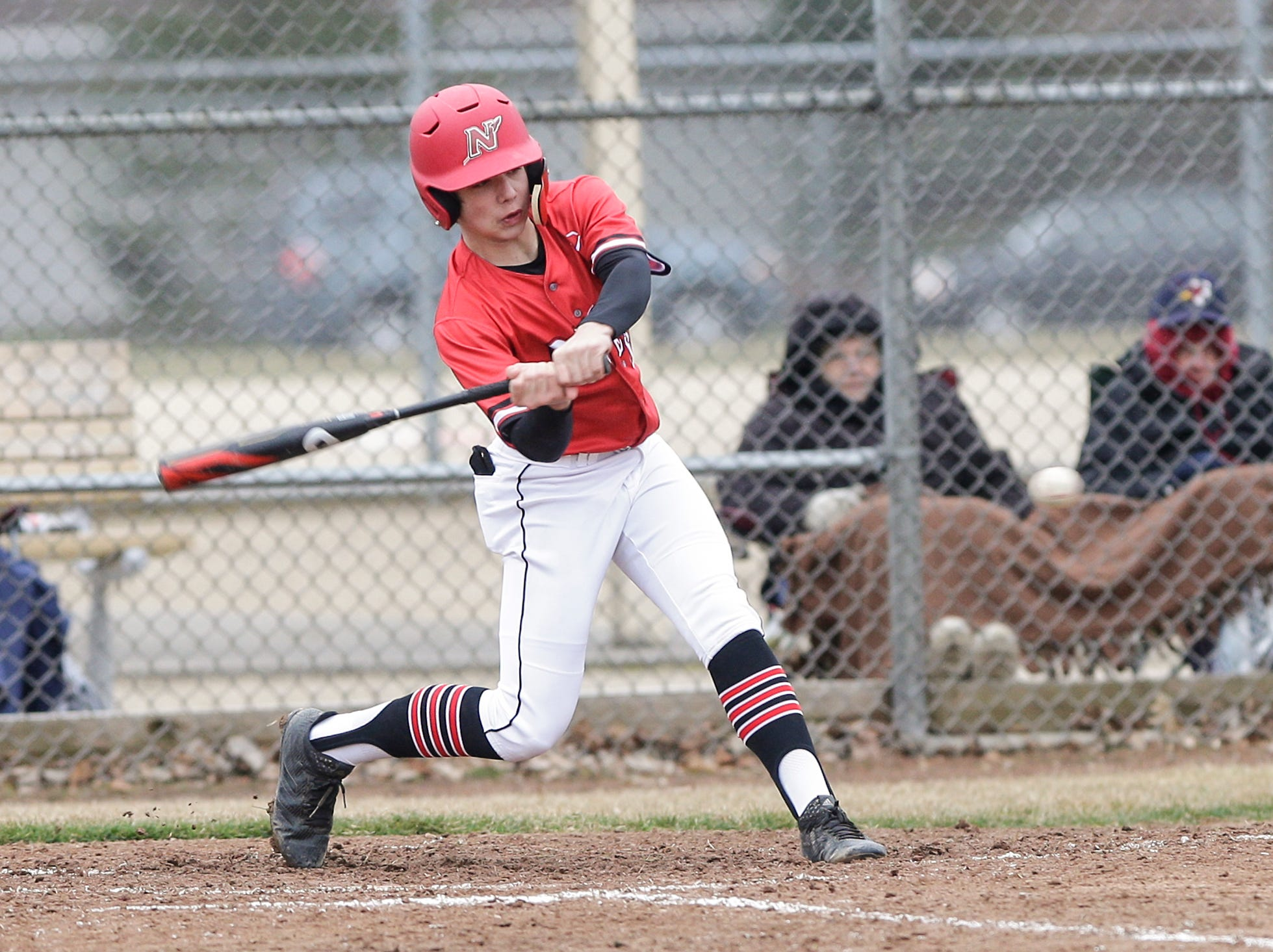 Neenah High School baseball's Jaden Hackbarth swings at a pitch against Fond du Lac High School during their game Thursday, April 18, 2019 in Fond du Lac, Wis. Doug Raflik/USA TODAY NETWORK-Wisconsin
