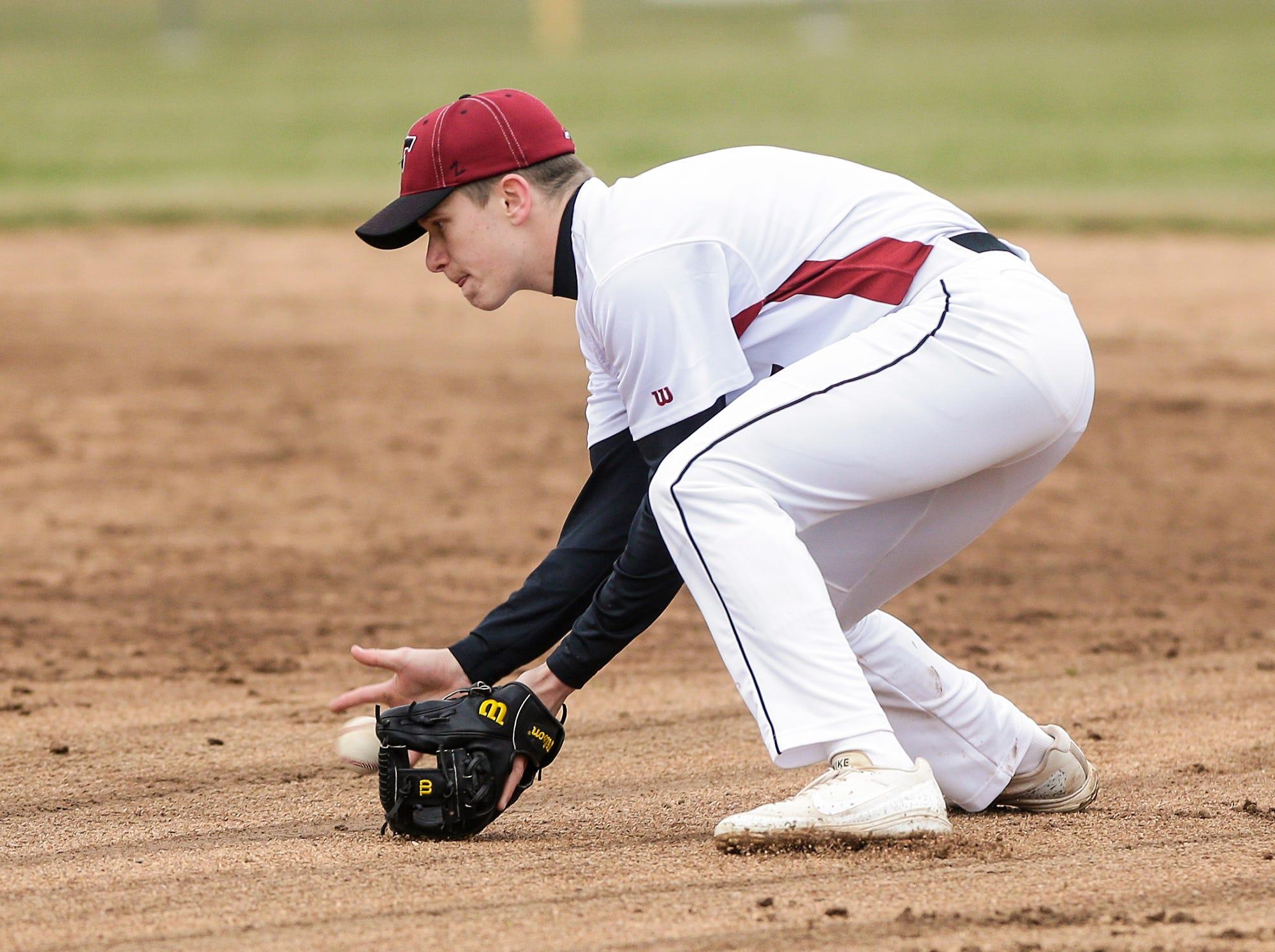 Fond du Lac High School baseball's Sam Hernandez fields a ground ball against Neenah High School during their game Thursday, April 18, 2019 in Fond du Lac, Wis. Doug Raflik/USA TODAY NETWORK-Wisconsin