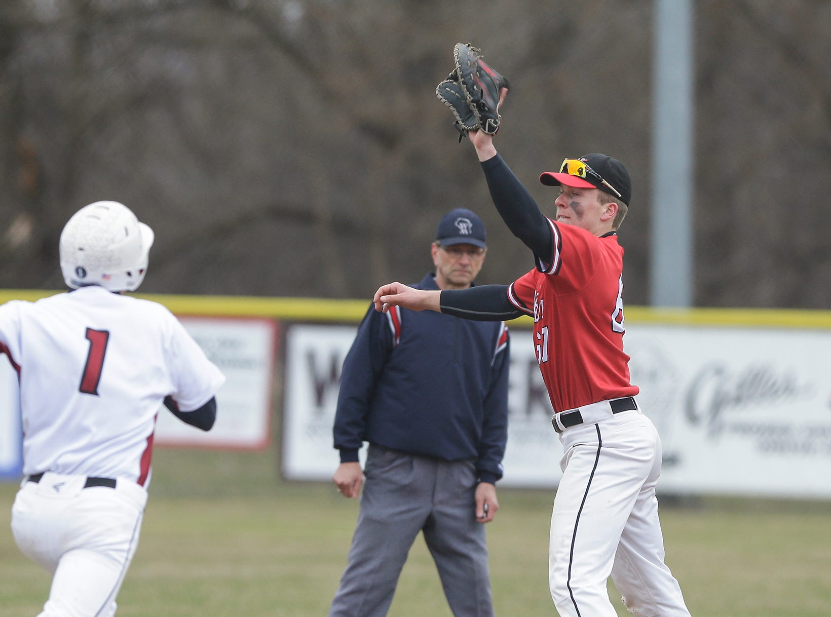 Neenah High School baseball's Logan Eiden tags out Fond du Lac High School's Caden Krug during their game Thursday, April 18, 2019 in Fond du Lac, Wis. Doug Raflik/USA TODAY NETWORK-Wisconsin