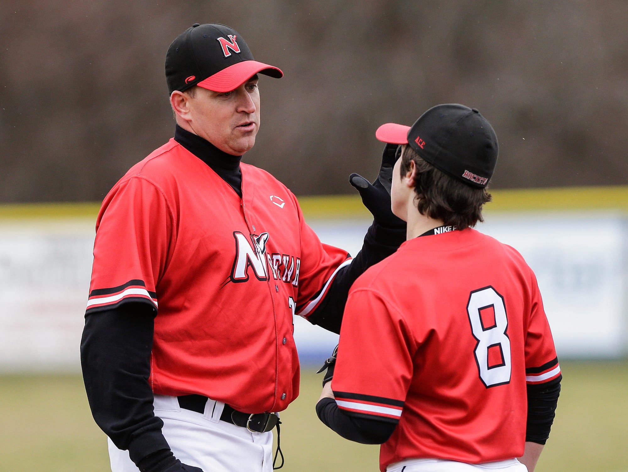 Neenah High School baseball's head coach Jack Taschner talks to Jaden Hackbarth during their game against Fond du Lac High School Thursday, April 18, 2019 in Fond du Lac, Wis. Doug Raflik/USA TODAY NETWORK-Wisconsin