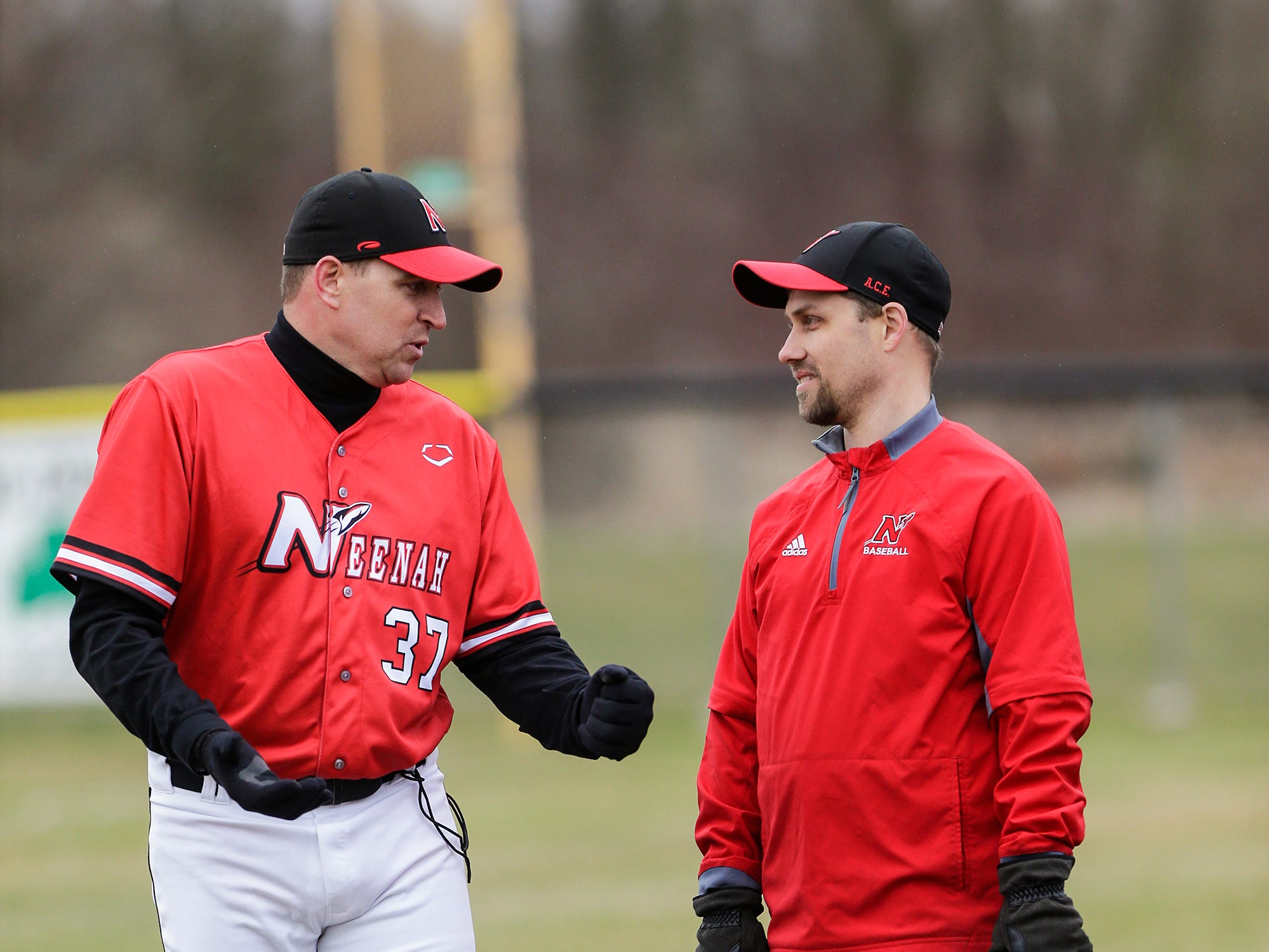 Neenah High School baseball's head coach Jack Taschner talks with assistant coach James Moen during their game against Fond du Lac High School Thursday, April 18, 2019 in Fond du Lac, Wis. Doug Raflik/USA TODAY NETWORK-Wisconsin