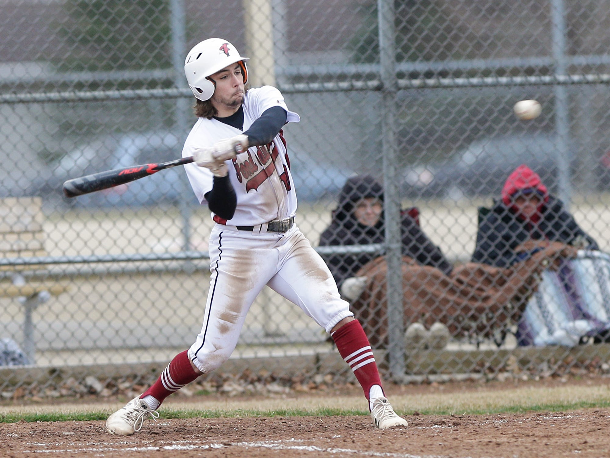 Fond du Lac High School baseball's River Reifsnider swings at a pitch against Neenah High School during their game Thursday, April 18, 2019 in Fond du Lac, Wis. Doug Raflik/USA TODAY NETWORK-Wisconsin