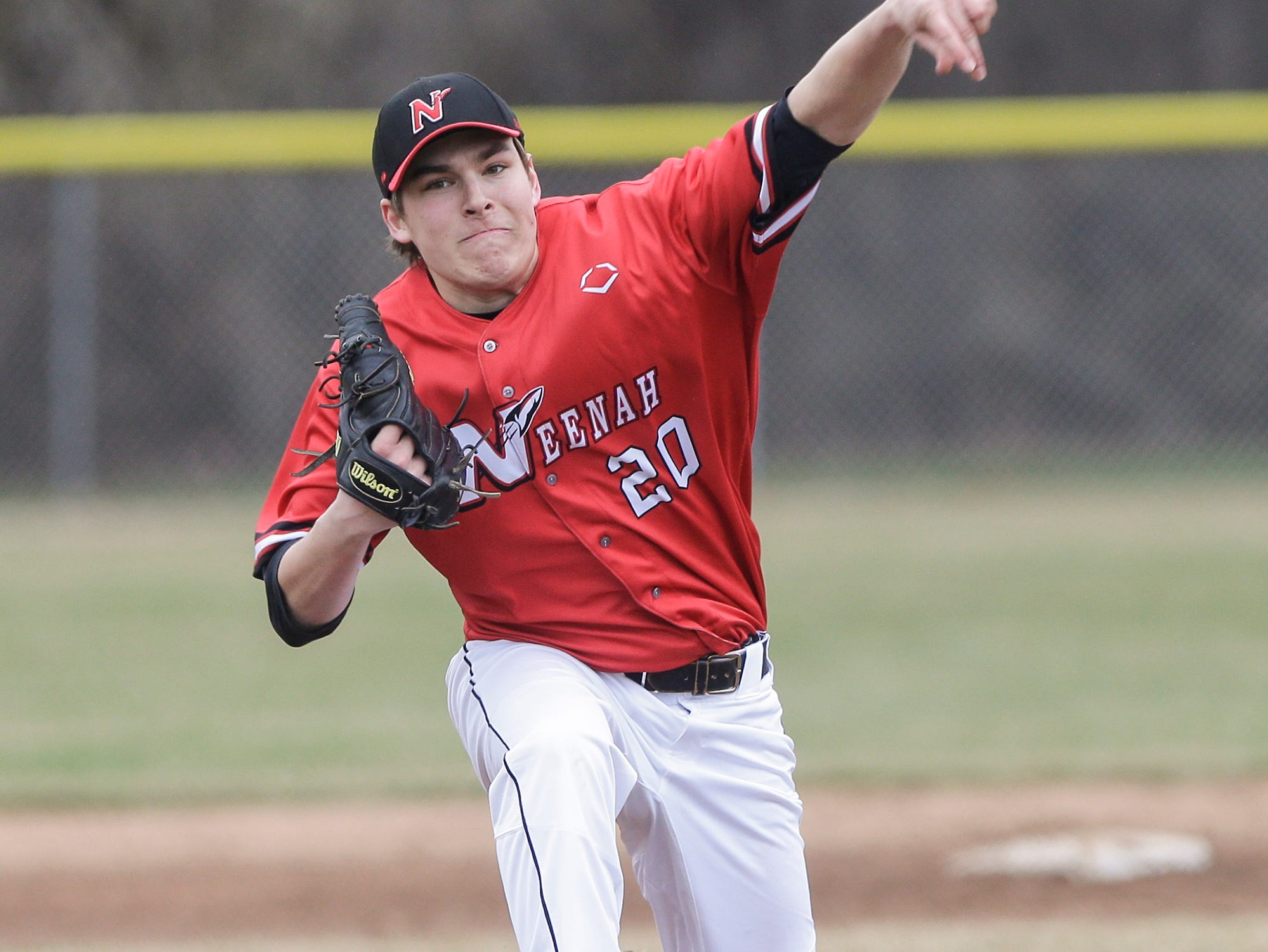 Neenah High School baseball's Jacob Leneau pitches against Fond du Lac High School during their game Thursday, April 18, 2019 in Fond du Lac, Wis. Doug Raflik/USA TODAY NETWORK-Wisconsin