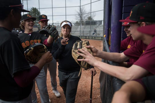 Assistant junior varsity baseball coach Jaelyn Manzanares jokes around with the team before a game against Fort Collins High School on Tuesday, April 16, 2019, at Fort Collins High School in Fort Collins, Colo.