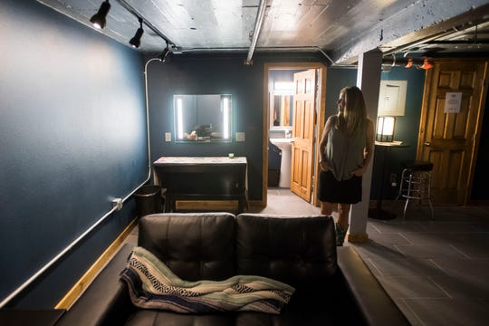 Co-owners Dani Grant looks over the newly renovated green room while giving a tour of the venue on Friday, April 19, 2019, at The Aggie Theatre in Fort Collins, Colo.