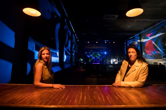 Co-owners Dani Grant, left, and Cheryl Liguori, pose for a portrait at one of the bars behind the floor on Friday, April 19, 2019, at The Aggie Theatre in Fort Collins, Colo.