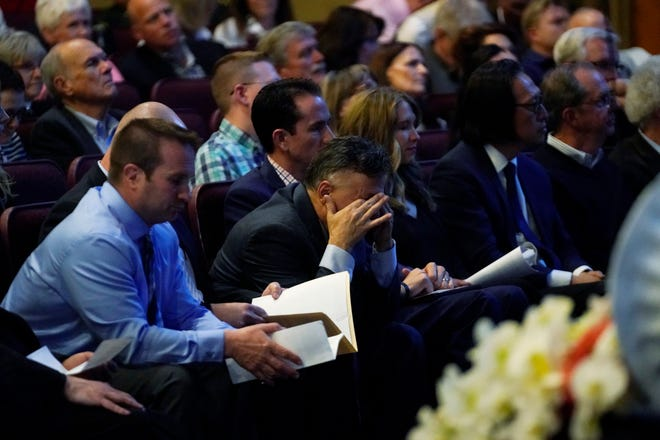 Frank DeAngelis, center, who was principal at Columbine High School during the massacre almost 20 years earlier, fights back tears during a faith-based memorial service for the victims at a community church Thursday, April 18, 2019, in Littleton, Colo. (Rick Wilking/Pool Photo via AP)