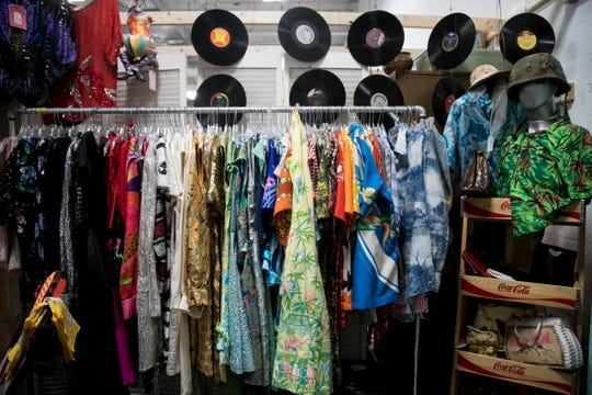 The booth next to Sally VanDuzer-Fulton's booth at Wildwood Antique Mall in Fort Myers has vintage clothing and handbags.