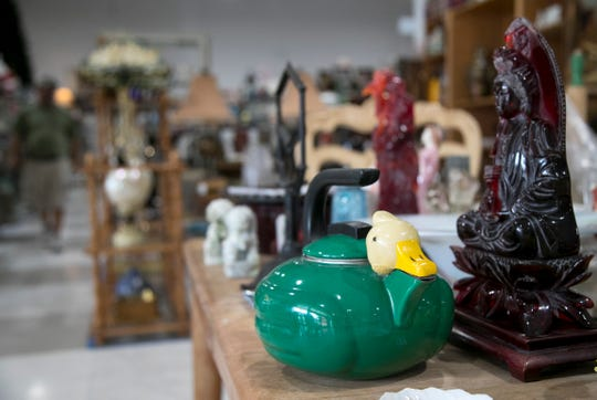 Wildwood Antique Mall has 156 booths, many of them rented, that are filled with all sorts of antiques and other items like vintage cookware, cameras, clothing, decor items and records.