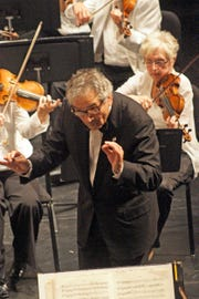 Victor Yampolsky, shown leading the Peninsula Music Festival Orchestra, will resign from the festival after its August symphony season, his 34th as its music director.