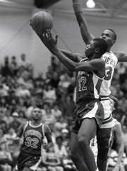 Riverside's Shaun Golden (12) drives to the basket against Greenville's David Young (23) during the 1988 AAA Upper State championship