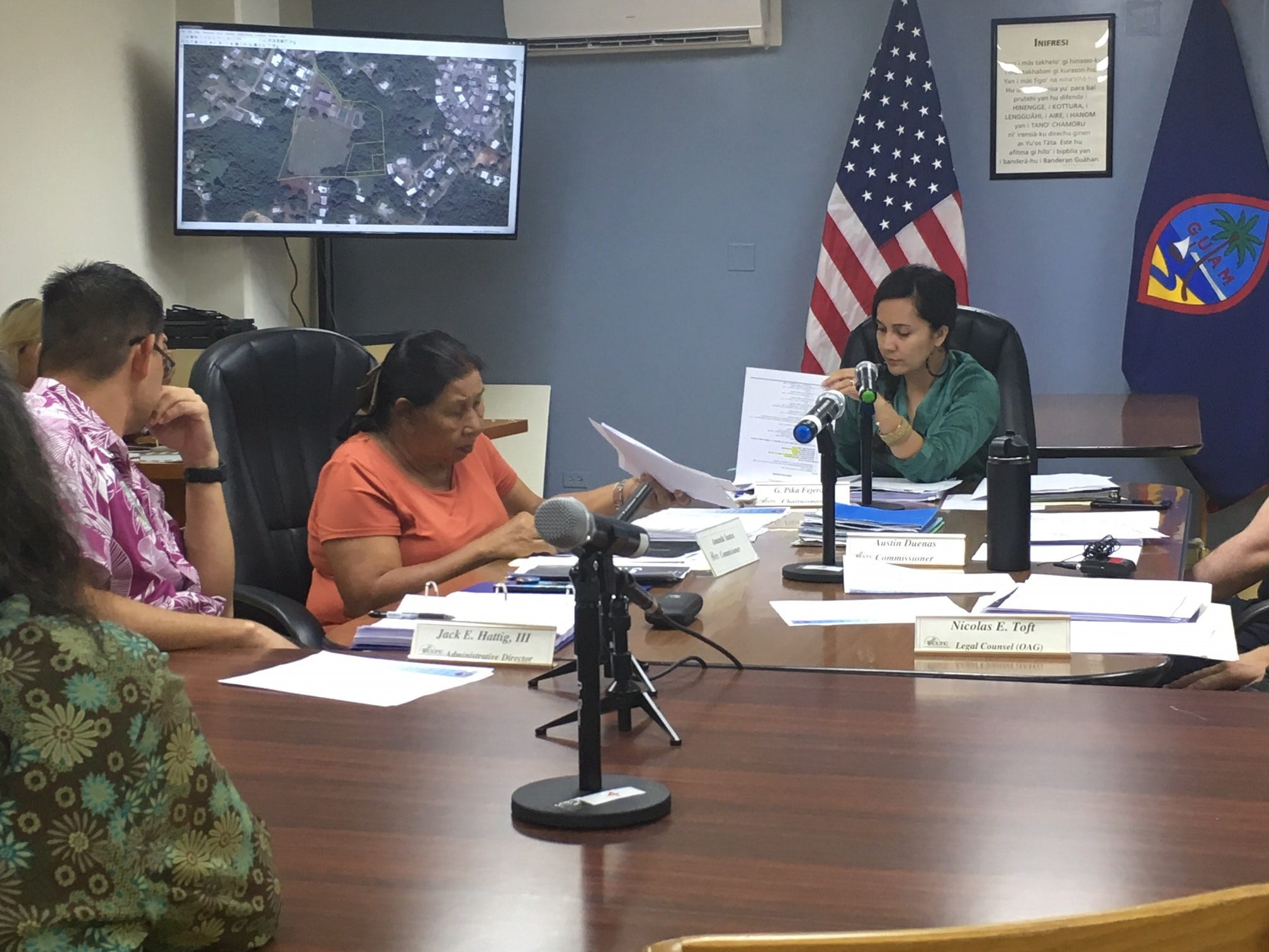 From left, CHamoru Land Trust Administrative Director Jack Hattig, Land Trust Commissioner Amanda Santos, and commission Chairwoman Pika Fejeran at a Land Trust meeting April 18. The commission met Thursdayto discuss a request by GTA TeleGuam to lease submerged Land Trust property in Agat and Tamuning.