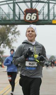 Henderson native Ryan Martin, who now lives in Fayetteville, Arkansas, runs in the Route 66 Marathon in Tulsa, Oklahoma.