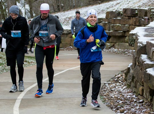 Henderson native Ryan Martin, right, participates in Run Bentonville in Bentonville, Arkansas. Martin, who currently lives in Fayetteville, Arkansas, will be running in the Derby Festival MiniMarathon Saturday in Louisville, where he spent the first 4 1/2 months of his life as an premature infant at Kosair's Children's Hospital.