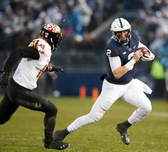 Penn State's Tommy Stevens (2) is chased down by Maryland's Jordan Mosley (18) during the first half of an NCAA college football game in State College, Pa., Saturday, Nov. 24, 2018.