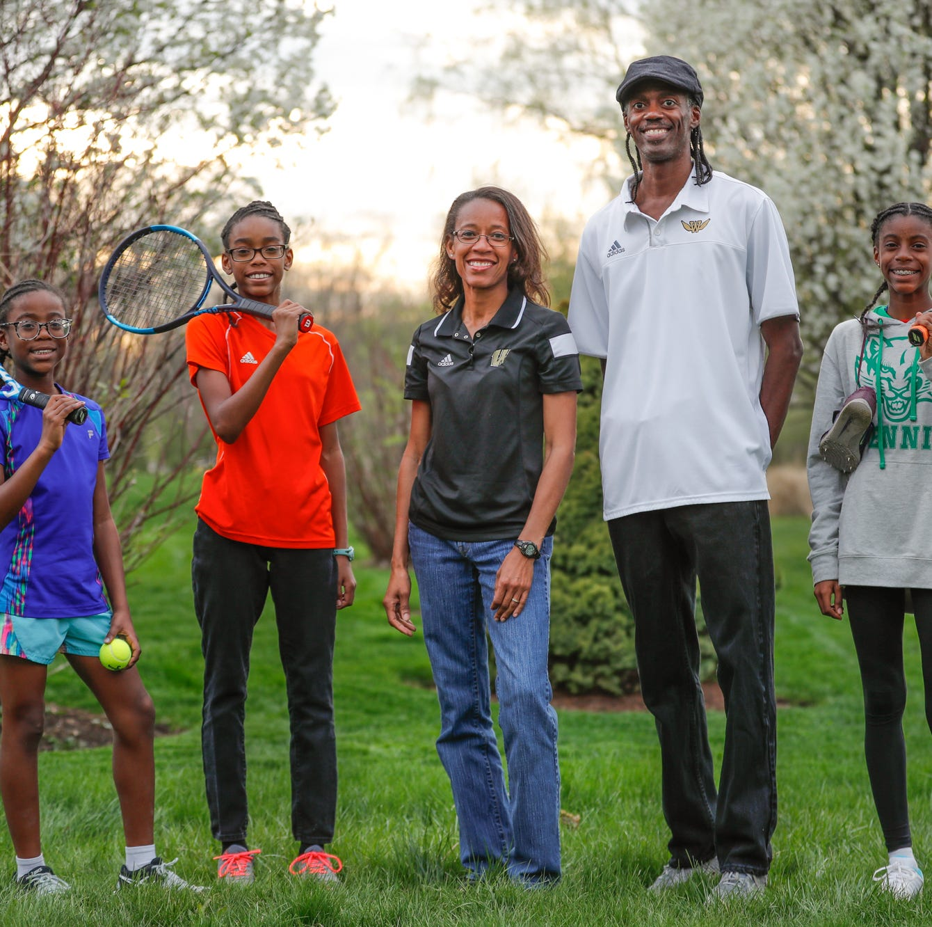 The Smith family, left to right, Kira 9, Samaya, 11, Le'gretta, Steve, and Laila 13, at their Indianapolis home on Wednesday April 17, 2019. Both parents are former track stars.  Le'gretta is Warren Central High School Girls Track Coach. Steve Smith who belongs to the Indiana State and Indiana Track halls of fame.