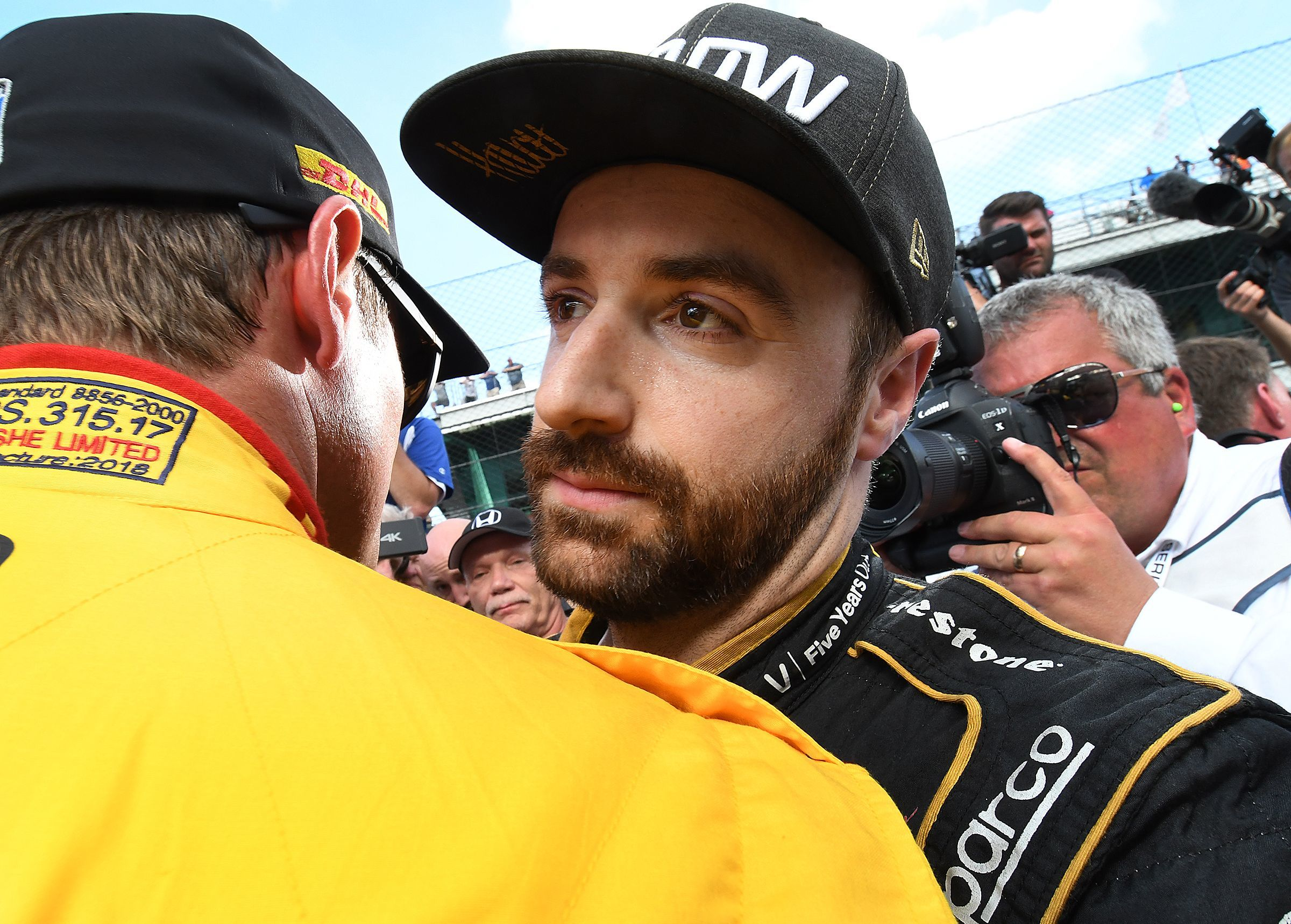 Schmidt Peterson Motorsports IndyCar driver James Hinchcliffe (5) got a hug from driver Ryan Hunter-Reay after he failed to make the field of 33 cars on qualification day for the 2018 Indianapolis 500.