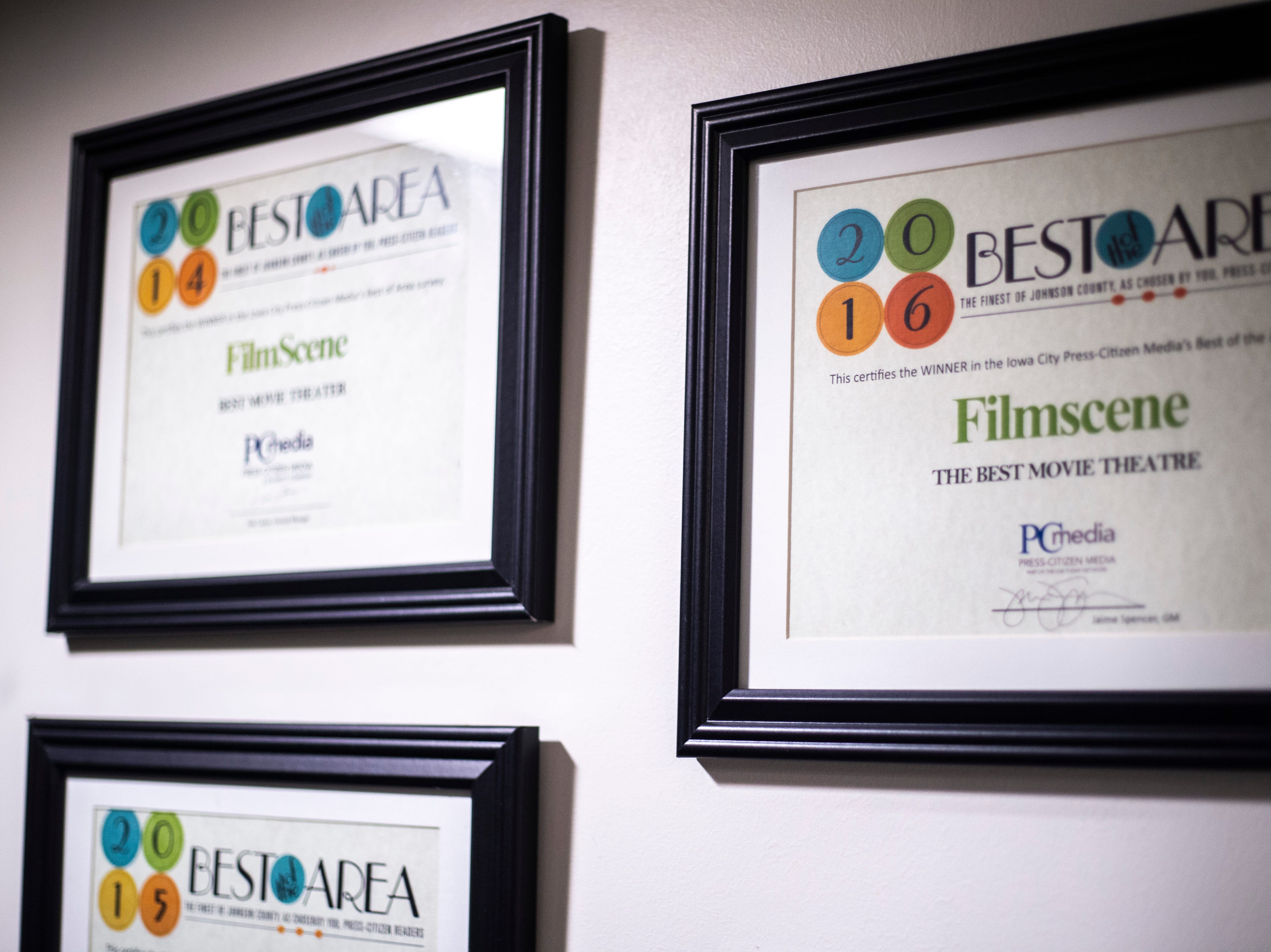 """Framed Press-Citizen Media """"Best of the Area"""" certificates hang in a hallway during a """"Late Shift at the Grindhouse"""" movie screening, Wednesday, April 17, 2019, at FilmScene in Iowa City, Iowa."""