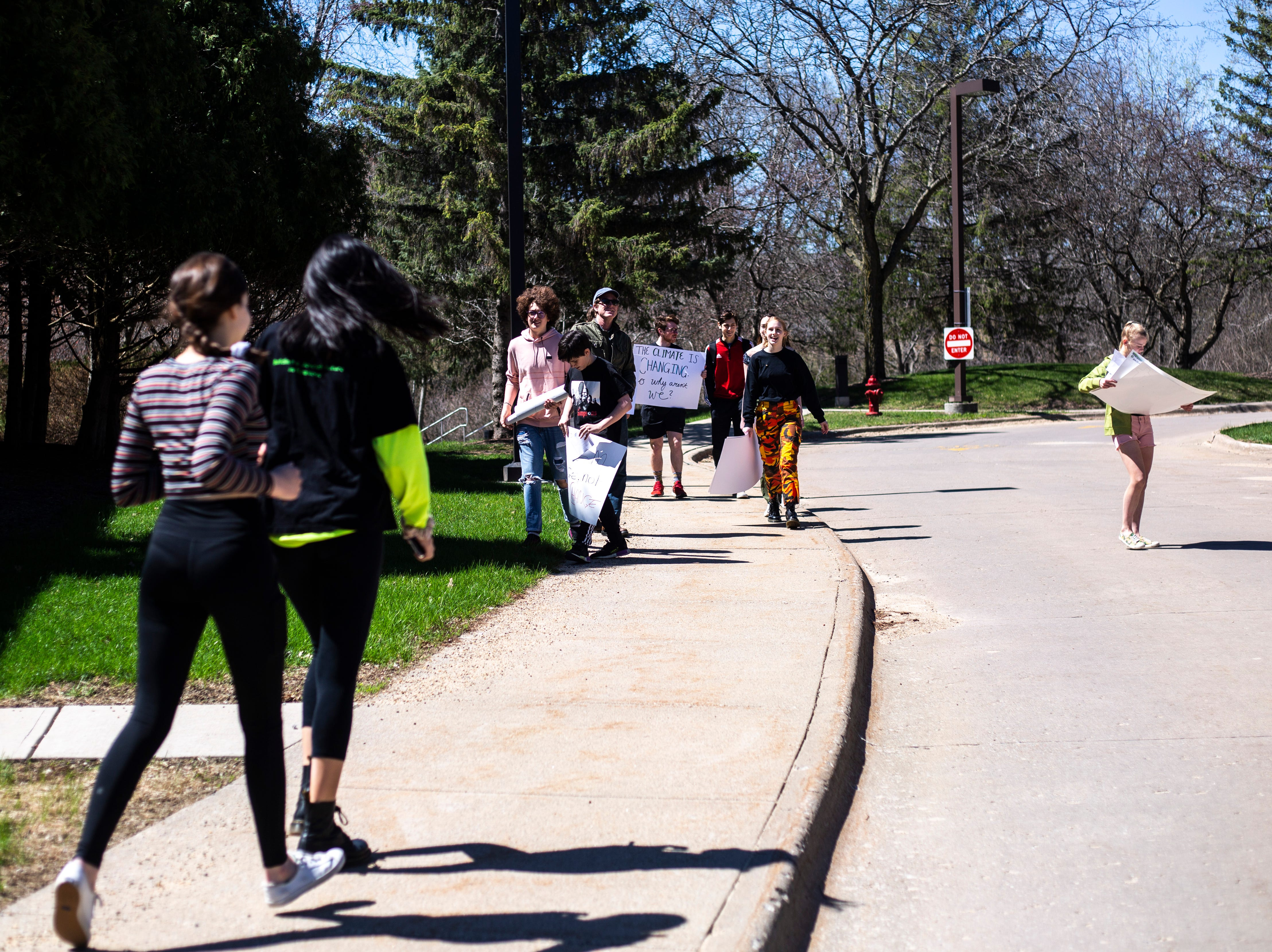 South East Junior High students meet up with community members during a weekly walkout demanding solar panels on school buildings, Friday, April 19, 2019, outside the Iowa City Community School District offices along North Dodge Street in Iowa City, Iowa.