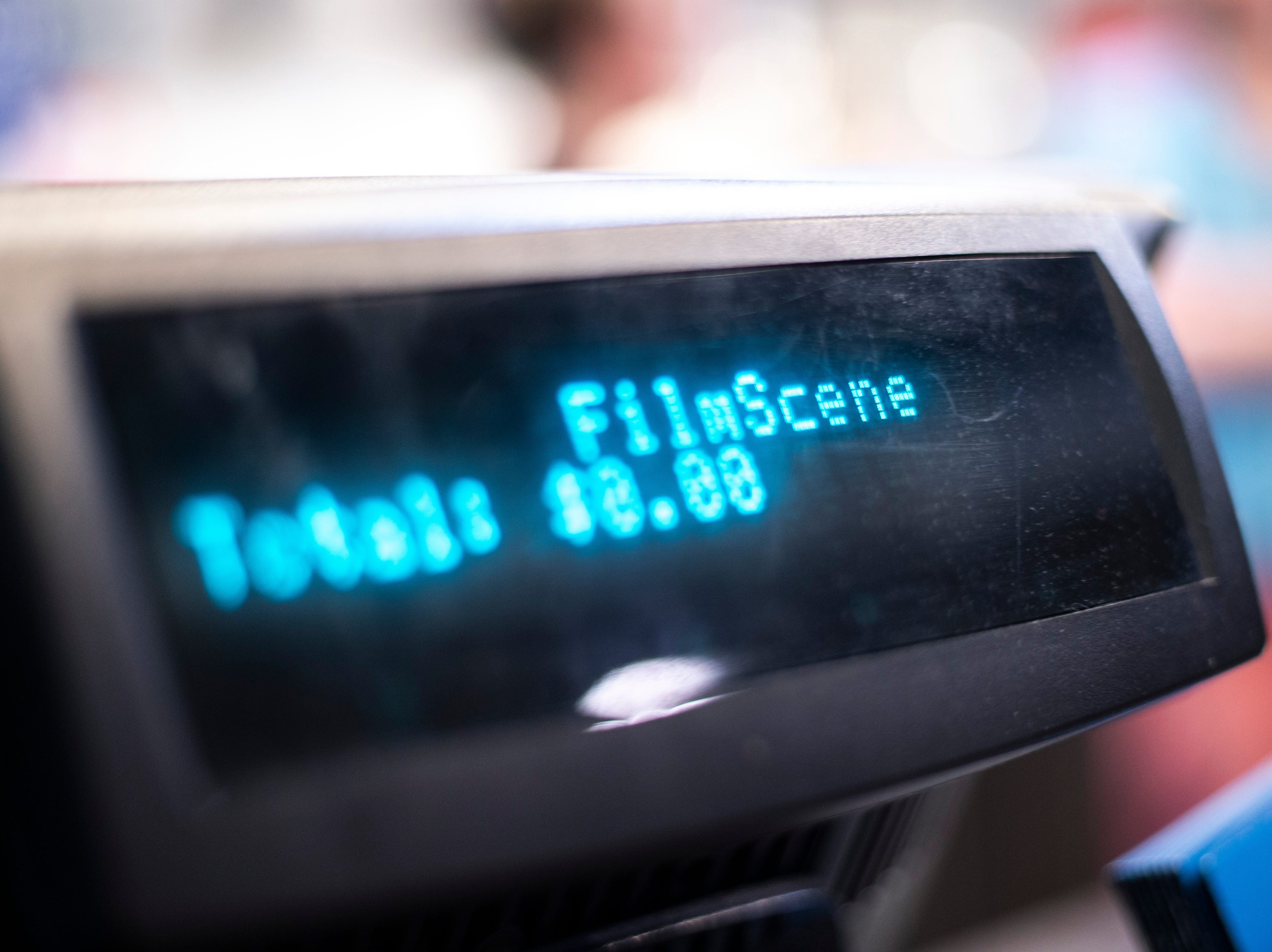 """""""FilmScene"""" scrolls across point of sale display during a """"Late Shift at the Grindhouse"""" movie screening, Wednesday, April 17, 2019, at FilmScene in Iowa City, Iowa."""
