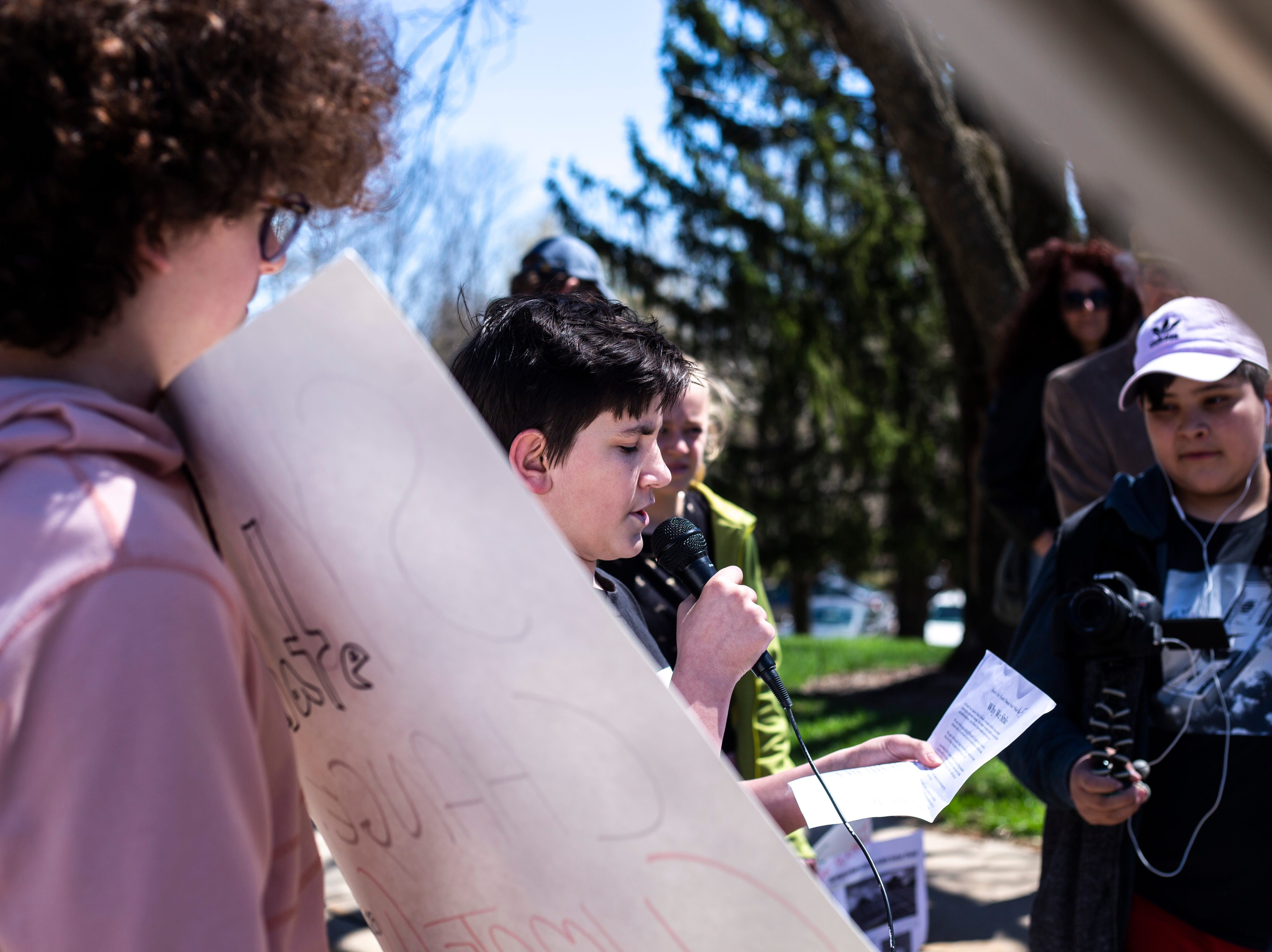 Alex Howe, a South East Junior High eight-grader, speaks during a weekly walkout demanding solar panels on school buildings, Friday, April 19, 2019, outside the Iowa City Community School District offices along North Dodge Street in Iowa City, Iowa.