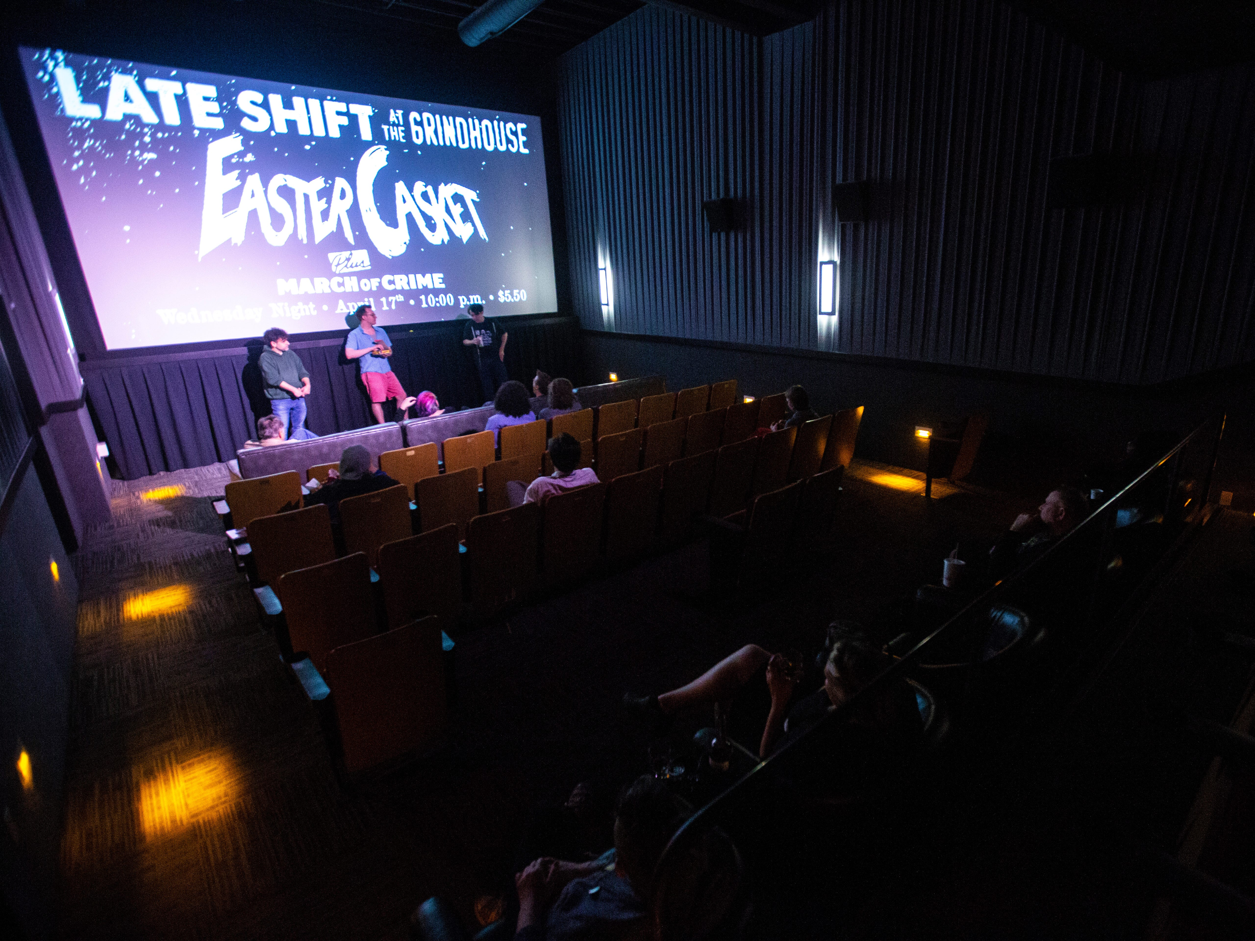"""FilmScene staffers give out door prizes during a """"Late Shift at the Grindhouse"""" movie screening, Wednesday, April 17, 2019, at FilmScene in Iowa City, Iowa."""