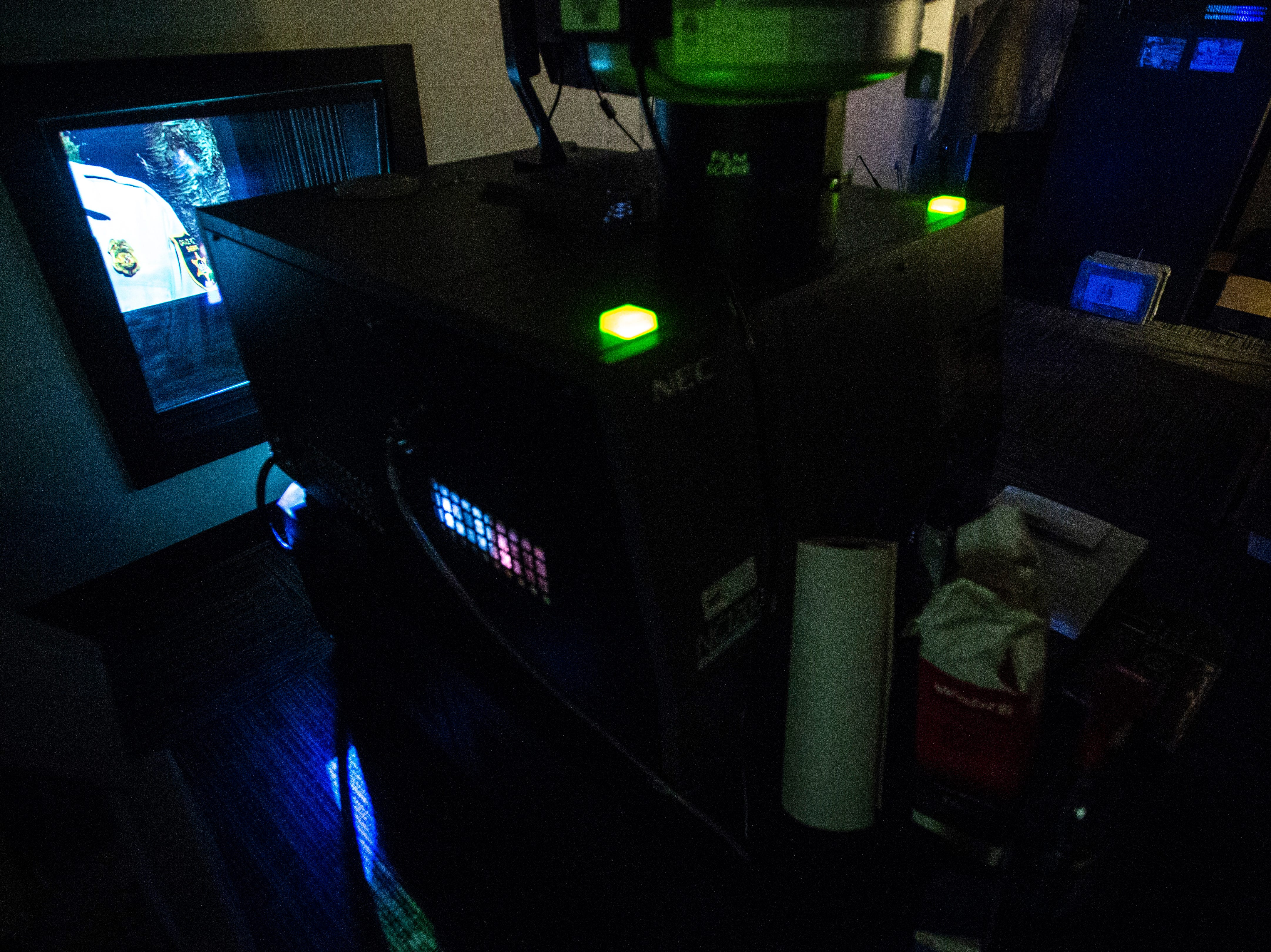 """A scene in the projection room during a """"Late Shift at the Grindhouse"""" movie screening, Wednesday, April 17, 2019, at FilmScene in Iowa City, Iowa."""