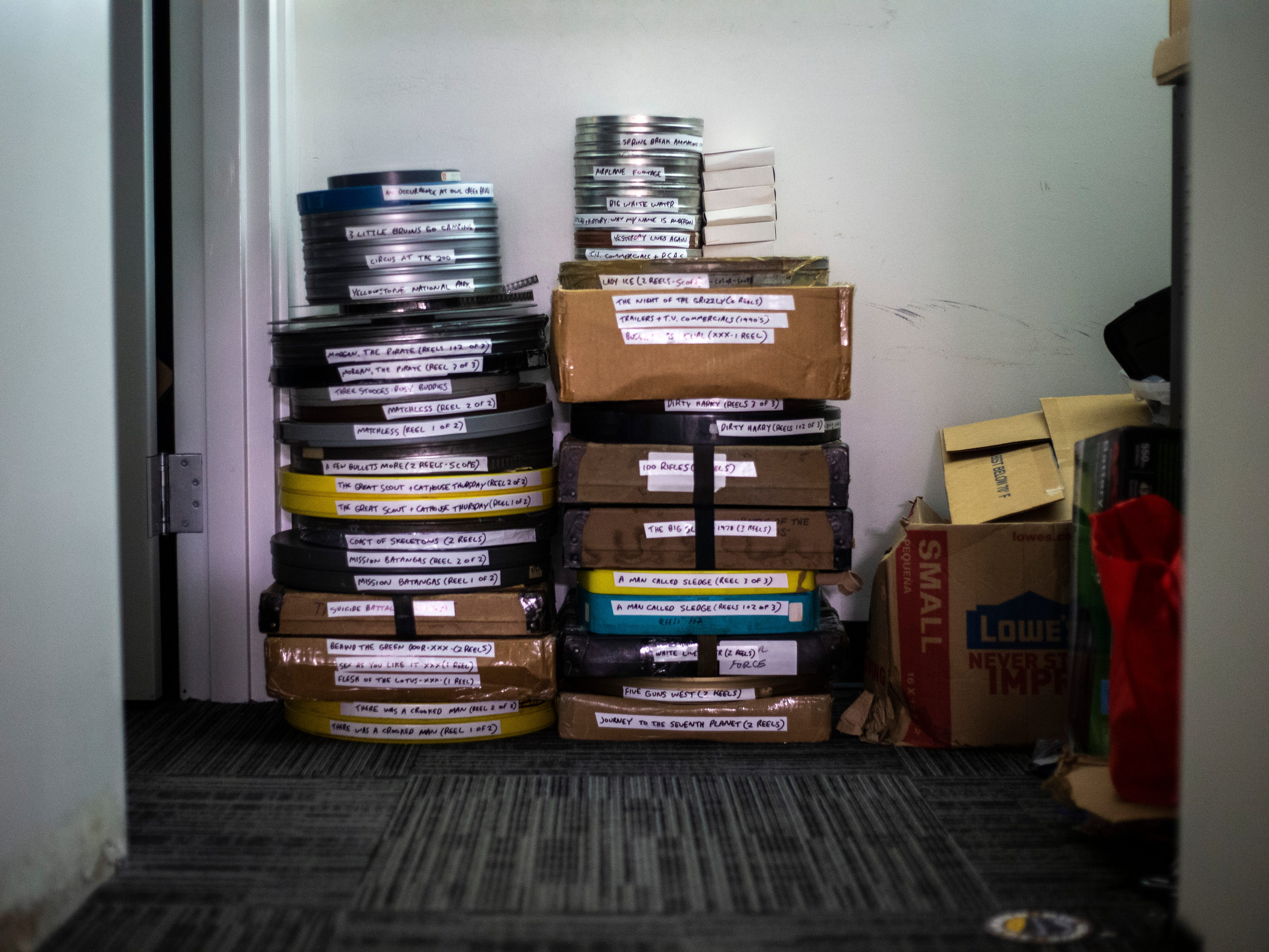 """Rolls of film get packed up outside the projection room during a """"Late Shift at the Grindhouse"""" movie screening, Wednesday, April 17, 2019, at FilmScene in Iowa City, Iowa."""
