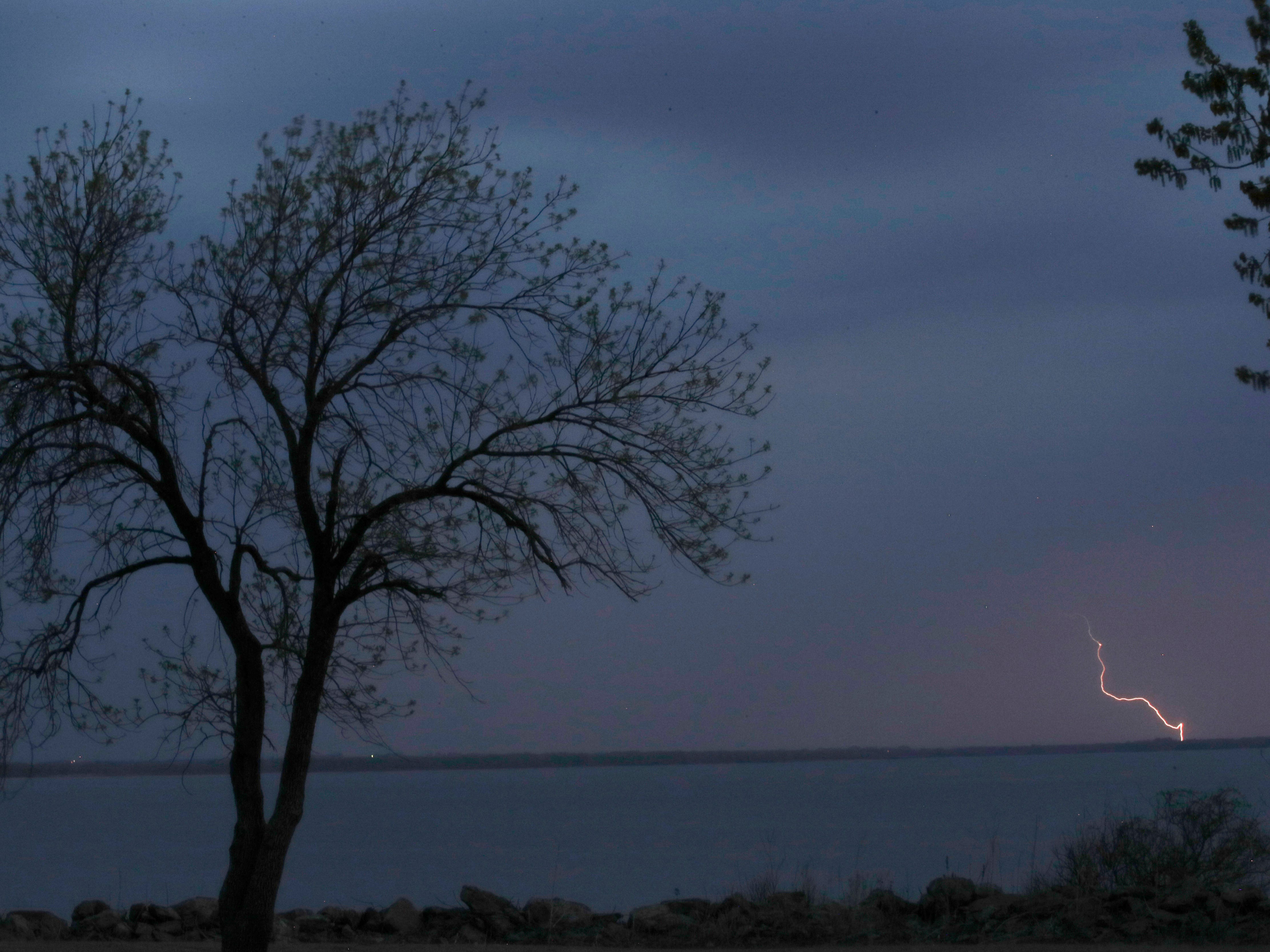 A thunderstorm moves across John Redmond Reservoir near Burlington, Kan., Wednesday, April 17, 2019. Several thunderstorms turned severe as they moved through the area.