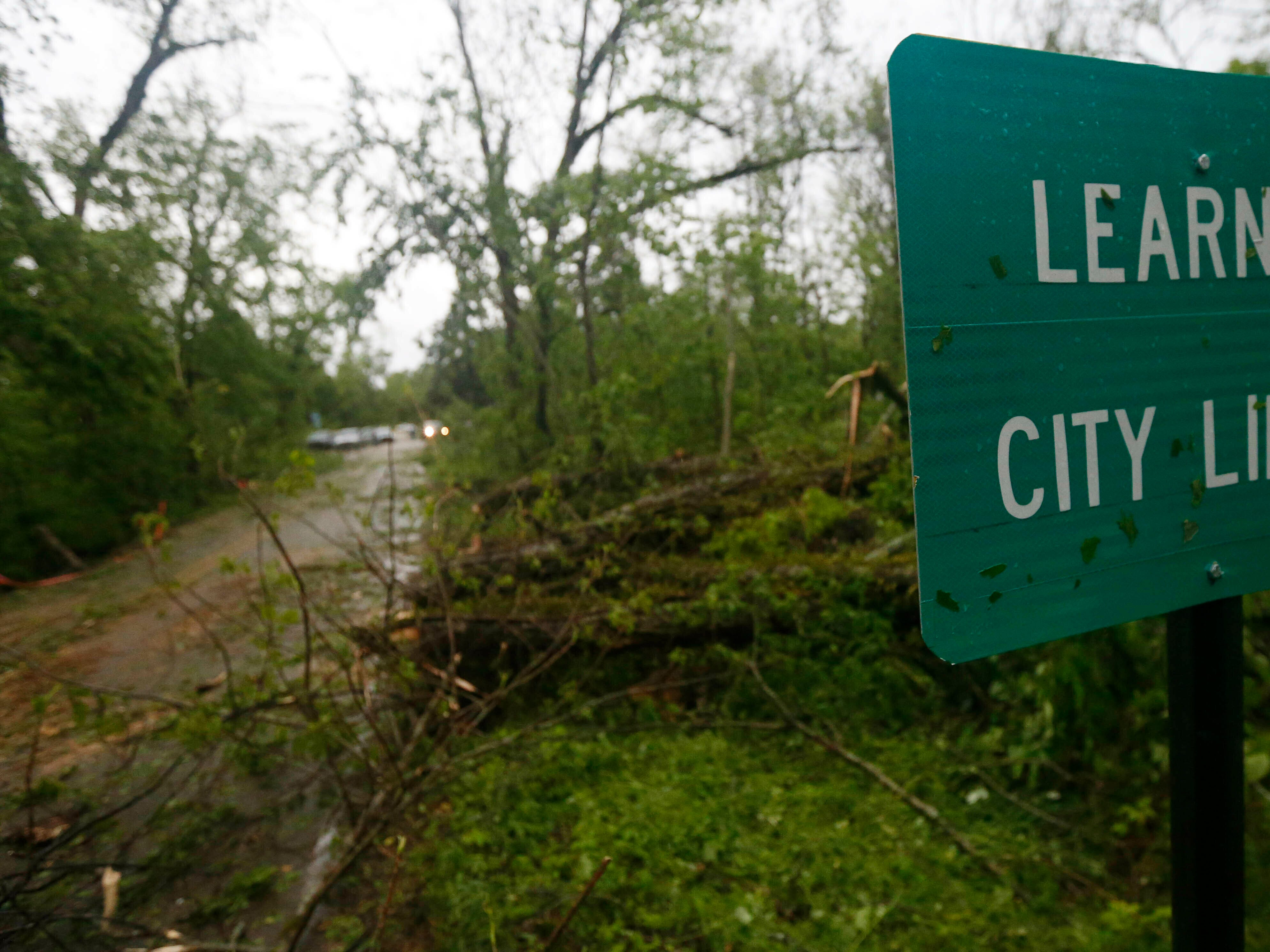 Fallen trees line the roads leading into the small community of Learned, Miss., Thursday, April 18, 2019. Several homes were damaged by fallen trees in the tree lined community. Strong storms again roared across the South on Thursday, topping trees and leaving more than 100,000 people without power across Mississippi, Louisiana and Texas.