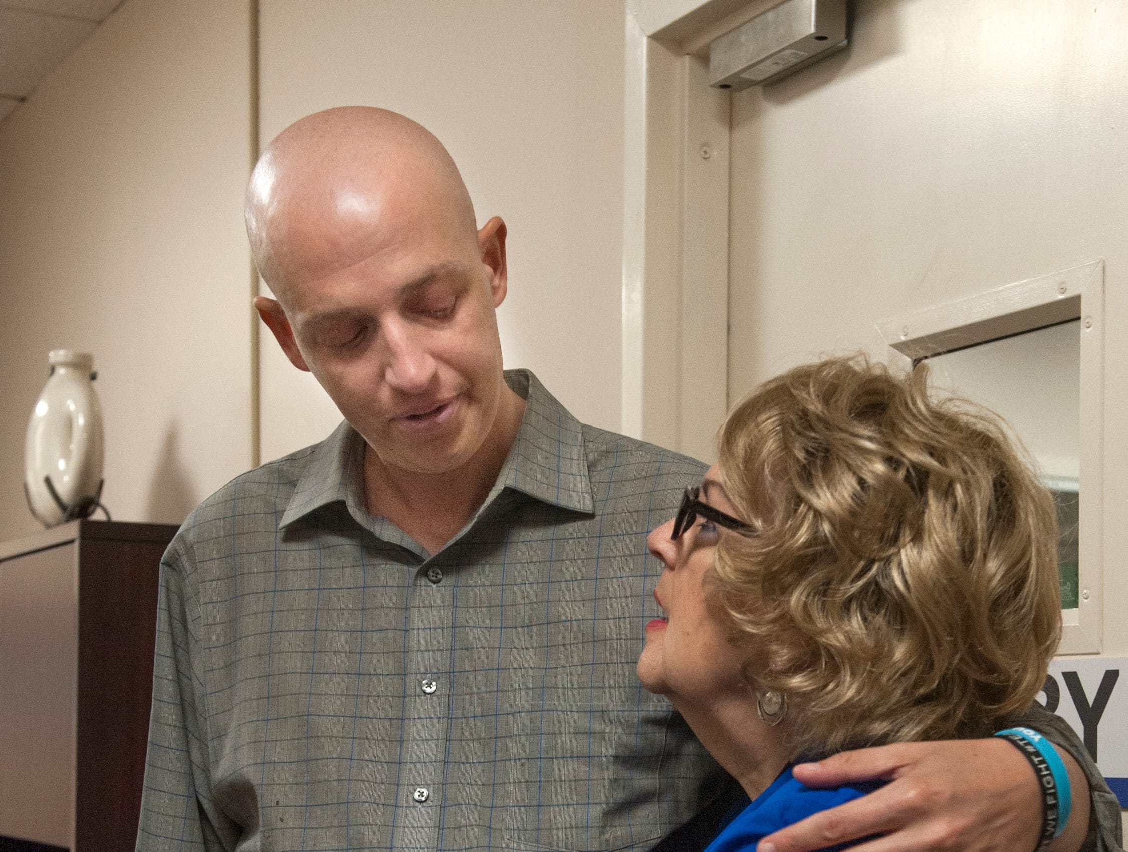 Mike Sands pauses to talk a few minutes with WLBT and FOX 40 receptionist Sally Brock when she asks to speak with him.