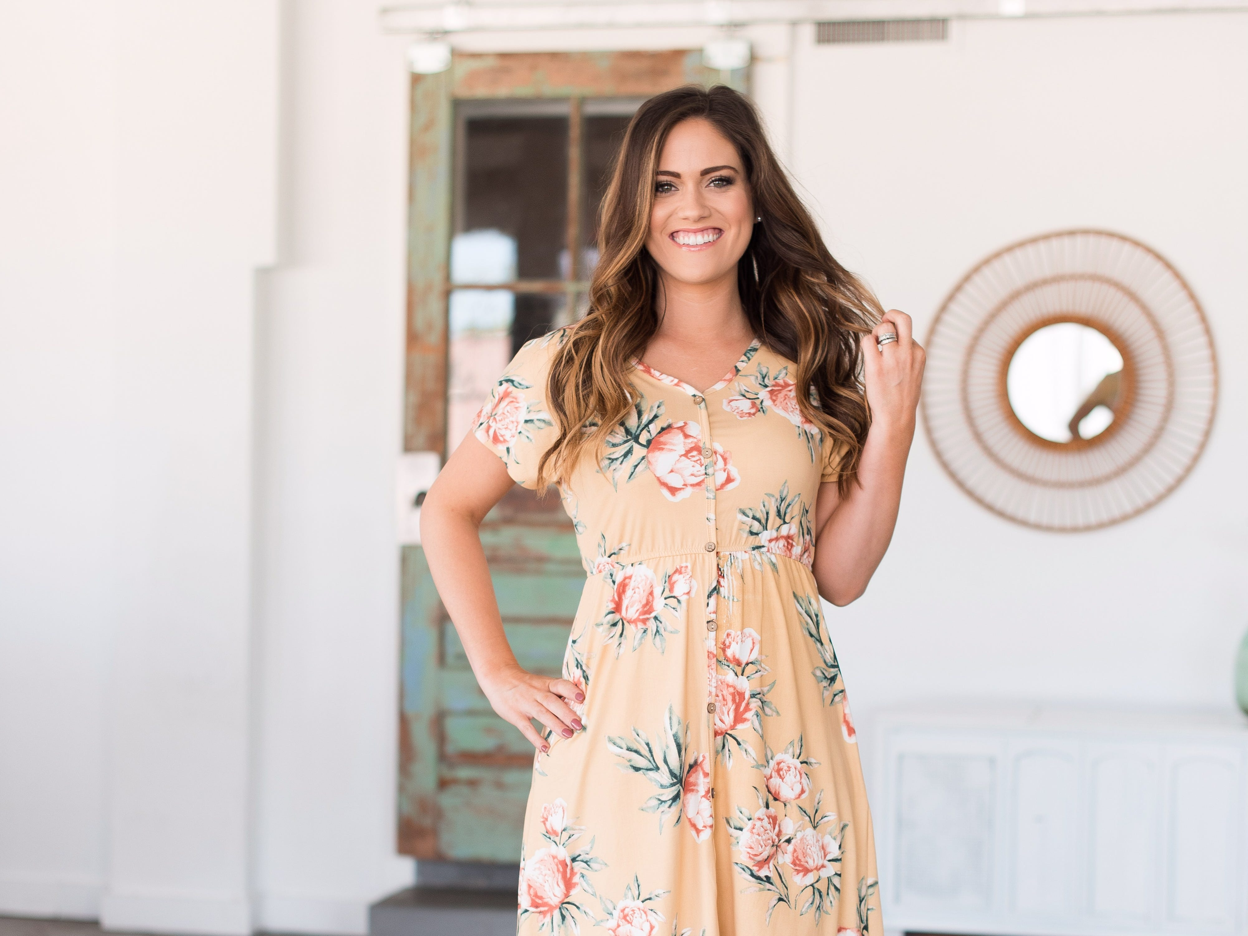 Whitney Bates models a dress from Bates Sisters' Boutique, an online clothing store that she, Erin Paine and Carlin Bates are starting together.