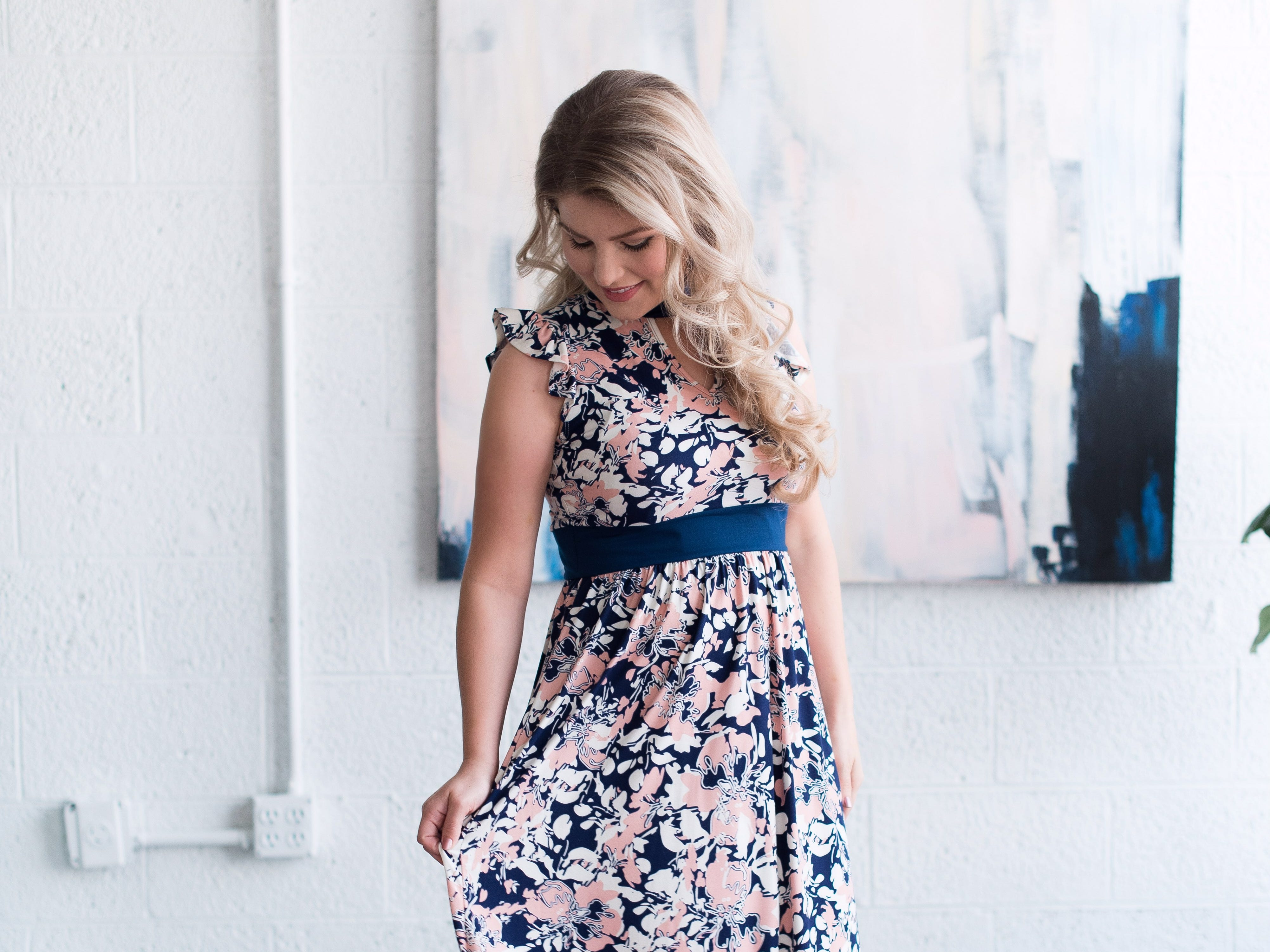 Erin Paine models a dress from Bates Sisters' Boutique, an online clothing store that she, Carlin Bates and Whitney Bates are starting together.
