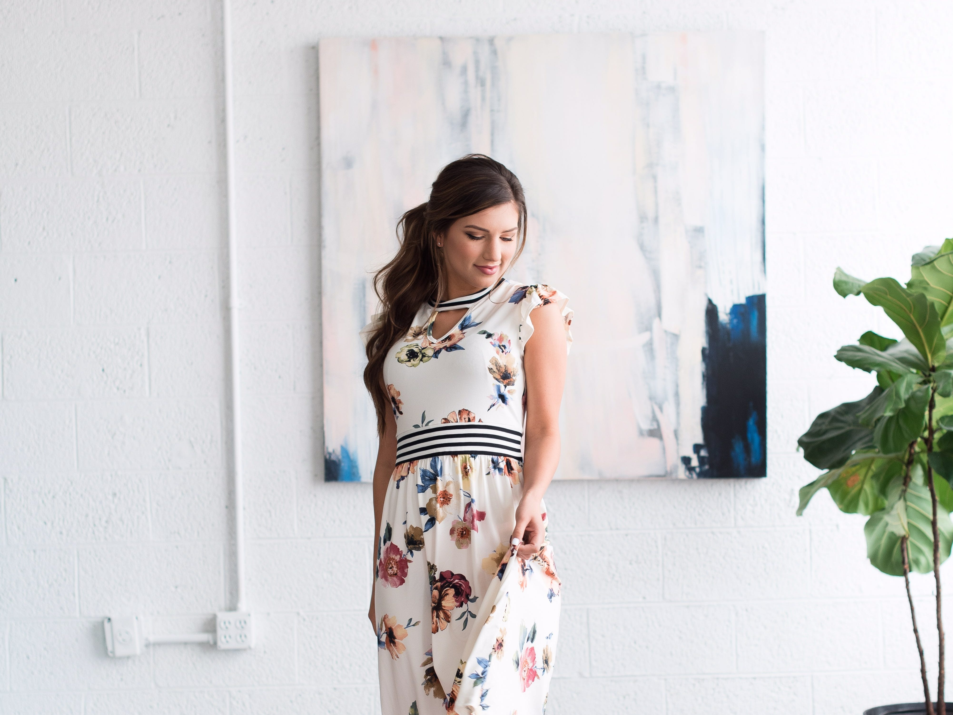 Carlin Bates models a dress from Bates Sisters' Boutique, an online clothing store that she, Erin Paine and Whitney Bates are starting together.