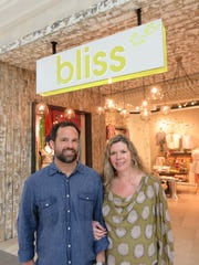 """Bliss owners Scott Schimmel and Lisa Sorensen at the new West Town Mall store on April 17. """"A lot of people are happy because they don't get to downtown that much,"""" said Sorensen."""