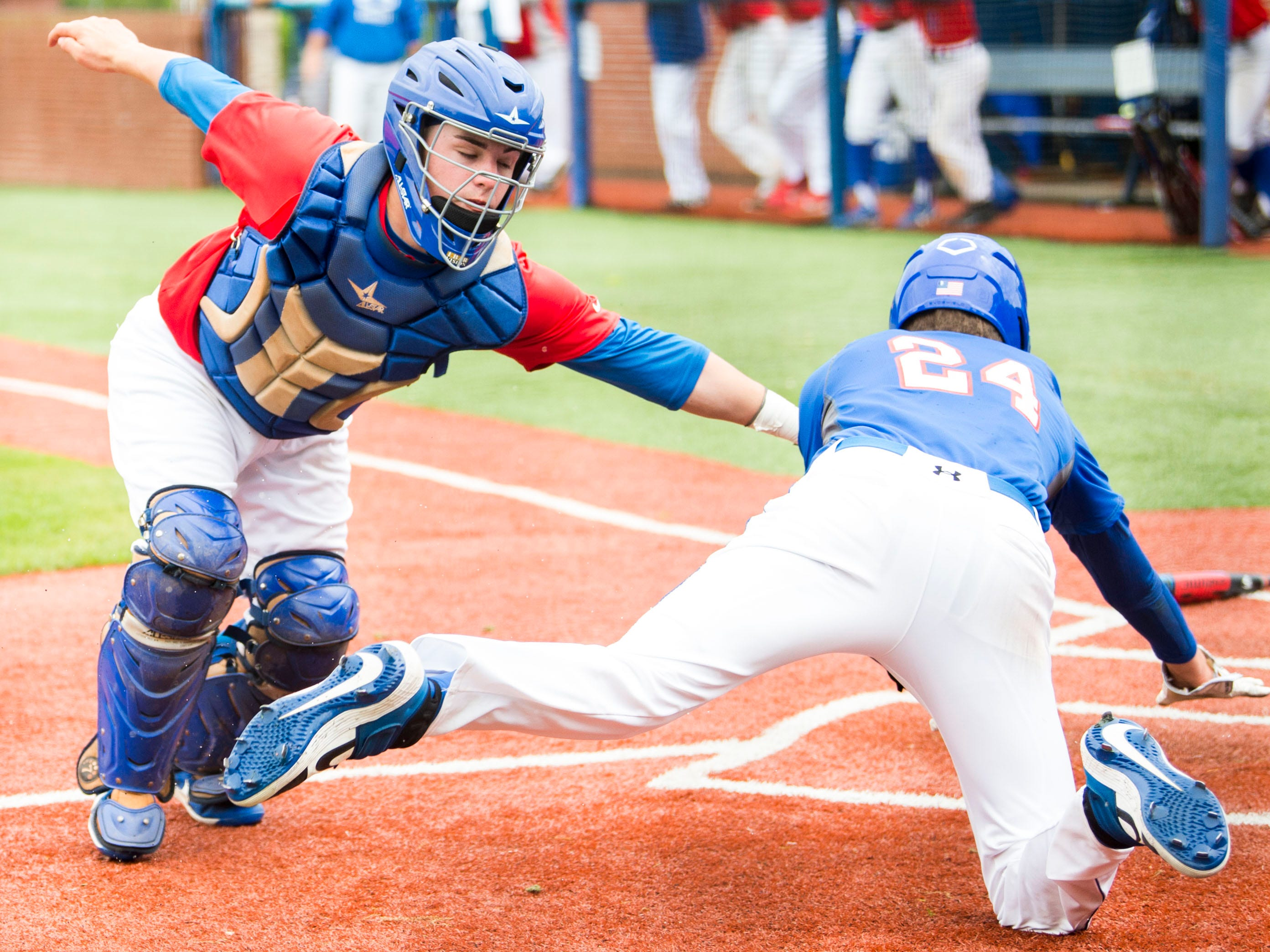 Bartlett's Jack Douglas (4) tags CAK's Cole Campbell (24) out at home during a baseball game between CAK and Bartlett held at CAK in Knoxville on Friday, April 29, 2019.