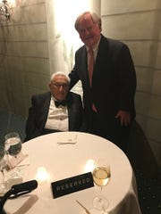 Former U.S. Secretary of State Henry Kissinger, 95, is greeted by Victor Ashe, former ambassador to Poland, on April 17, 2019, at the William Buckley Society annual dinner at the Pierre Hotel in New York City.
