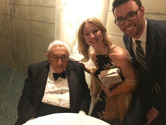 Martha Ashe, daughter of Victor and Joan Ashe, met former U.S. secretary of State Henry Kissinger in New York on April 17, 2019. Her boyfriend, Tim Bishop, is with her.