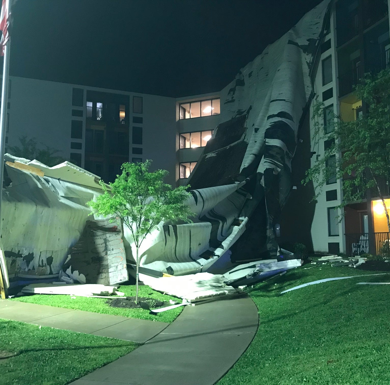 High winds caused a partial roof collapse at an...