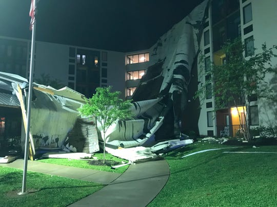 High winds caused a partial roof collapse at an apartment building near downtown Knoxville early Friday, April 19, 2019.