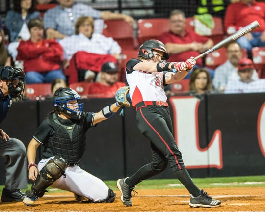UL's Julie Rawls makes contact with the ball as the Ragin' Cajuns play the Georgia State Panthers at Lamson Park on Thursday, April 18, 2019.