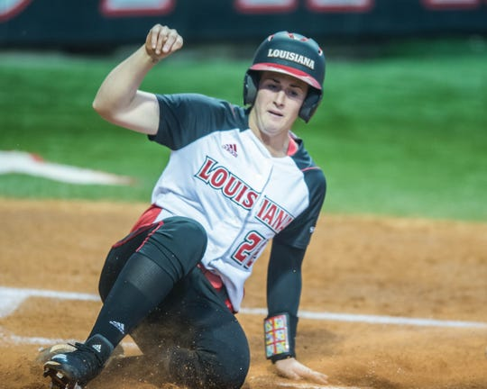 UL's Alissa Dalton scores the Ragin' Cajuns' first run as the Cajuns play the Georgia State Panthers at Lamson Park on Thursday, April 18, 2019.